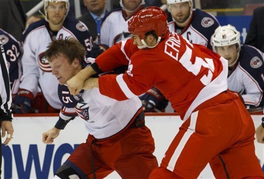 Columbus Blue Jackets right wing Derek Dorsett (15) and Detroit Red Wings defenseman Jonathan Ericsson (52), of Sweden, fight during the second period of an NHL hockey game in Detroit, on Friday, Oct. 21, 2011. (AP Photo/Rick Osentoski)