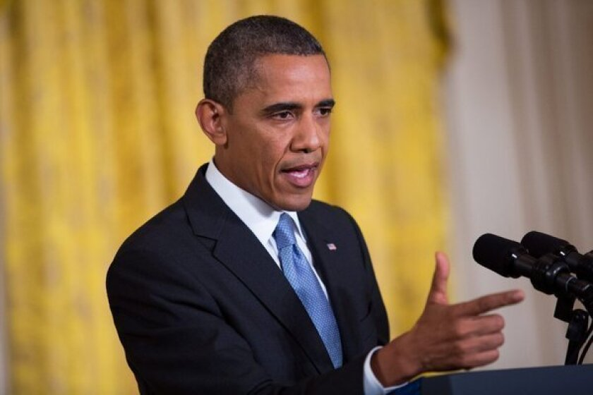 The Obama administration has legally justified the National Security Agency's collection of phone data from every American by citing a provision of the Patriot Act that applies to business records. Above, President Obama is seen at a news conference on Aug. 9 in which he discussed NSA surveillance and terrorist threats.