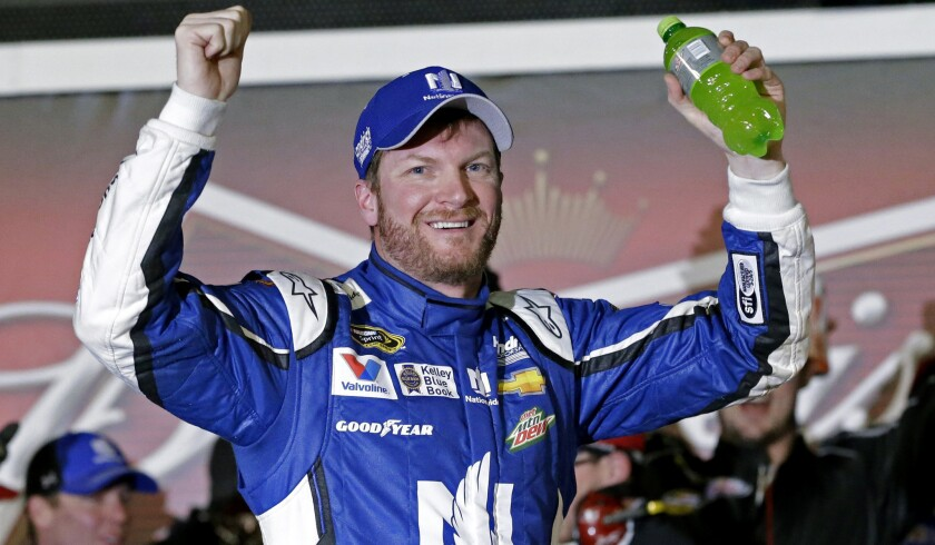 NASCAR driver Dale Earnhardt Jr. celebrates after winning the first of two qualifying races for the Daytona 500 on Thursday night.