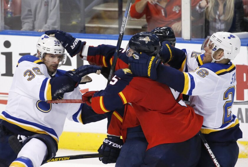 St. Louis Blues right wing Troy Brouwer, left, and center Paul Stastny, right, scuffle with Florida Panthers defenseman Aaron Ekblad (5) and left wing Jussi Jokinen, center rear, during the third period of an NHL hockey game, Friday, Feb. 12, 2016, in Sunrise, Fla. The Blues defeated the Panthers 5