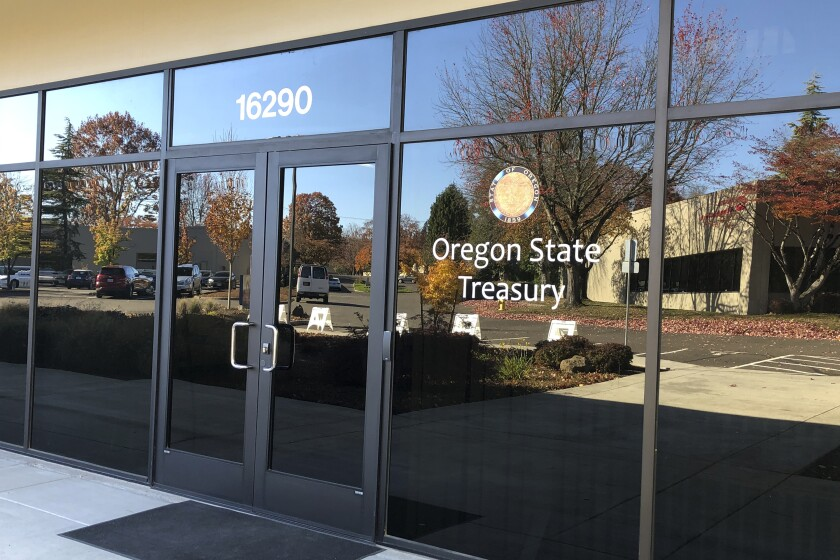 FILE - This Oct. 30, 2019, file photo show the Oregon State Treasury office in Tigard, Ore. Oregon was Novalpina's first major investor. Stephen Peel and Stefan Kowski, two founding Novalpina Capital partners, showed up at Oregon treasury offices in the Portland suburb of Tigard in November 2017 to make a pitch to the Oregon Investment Council, which oversees the state's $90 billion pension fund. Novalpina Capital has been saddled with both an internal dispute among its founding partners and an explosive report showing NSO Group's spyware has been widely misused around the globe. (AP Photo/Andrew Selsky, File)