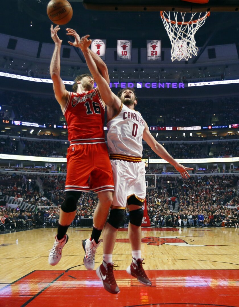 Cleveland Cavaliers forward Kevin Love (0) knocks the ball from the hands of Chicago Bulls center Pau Gasol (16) during the first half of an NBA basketball game in Chicago on Saturday, April 9, 2016. (AP Photo/Jeff Haynes)