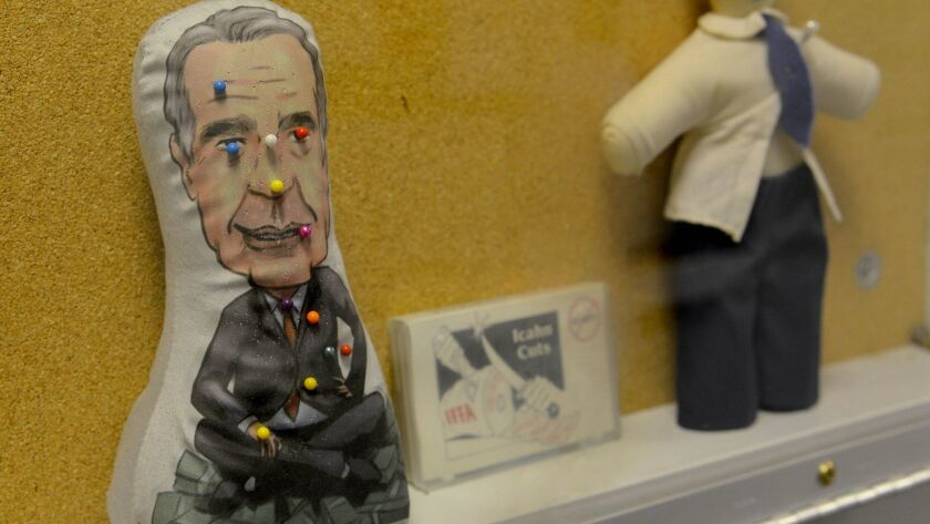 Voodoo dolls representing onetime TWA shareholder Carl Icahn are among artifacts on display at the T