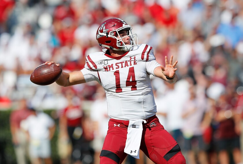 New Mexico State quarterback Josh Adkins looks to pass during last week's game at Alabama.