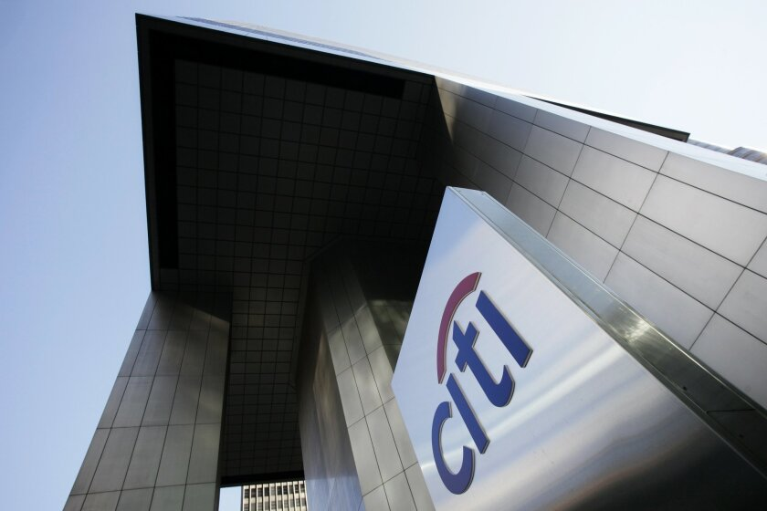 FILE - This Oct. 16, 2012 file photo shows the Citibank building in New York. Citigroup on Monday, July 14, 2014 said that its net income dropped in the second quarter after it took a $3.8 billion charge to settle claims over its risky subprime mortgage business. (AP Photo/Mark Lennihan, File)