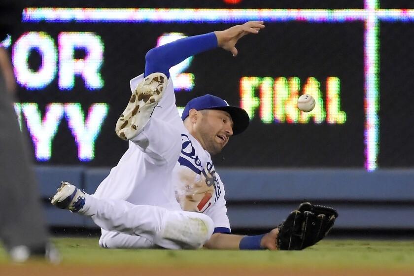 Dodgers left fielder A.J. Pollock can't make the catch.
