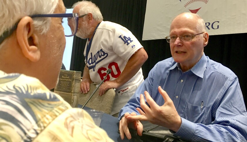 David Neft discusses how The Baseball Encyclopedia was created with an attendee at the SABR convention in San Diego on June 28, 2019.