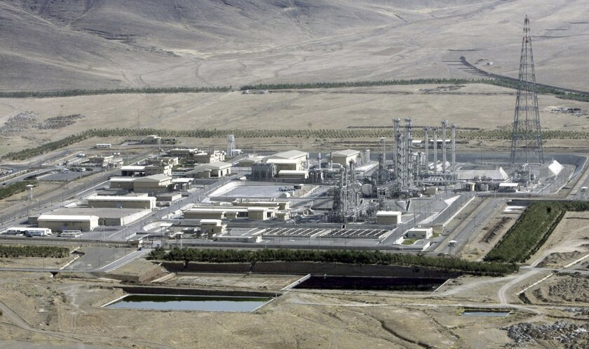 FILE- In this Saturday, Aug. 26, 2006 file photo, an aerial view of a heavy-water production plant in the central Iranian town of Arak. Iran's reformers and moderate conservatives welcomed an agreement between Iran and six world powers on how to implement a nuclear deal struck in November, saying i