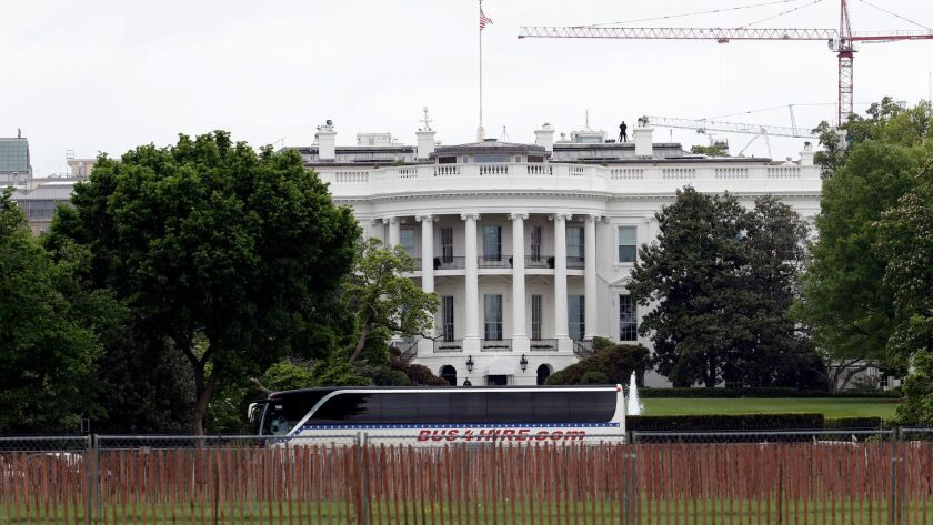 A bus carrying U.S. senators at the White House on Wednesday.