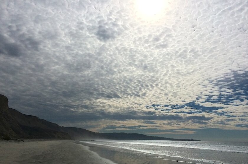 Altocumulus clouds drift above Torrey Pines State Reserve on Tuesday.