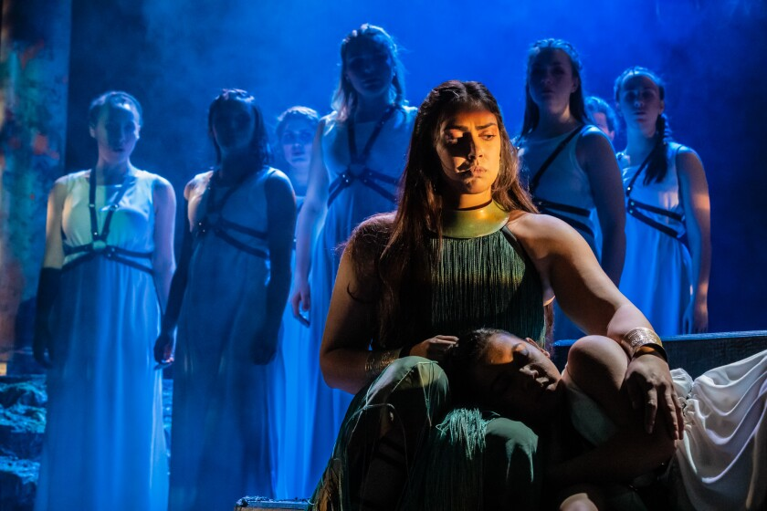 Penelope, played Hope Andrejack, sings a lullaby to comfort her son Telemachus, played by Justine Rafael, to explain how Odysseus went to Troy in Margaret Atwood's 'The Penelopiad,' which is playing at the Claire Trevor Theatre through Feb. 9.