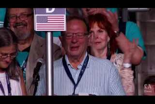 An emotional Larry Sanders casts roll call vote for his brother Bernie at the Democratic National Convention
