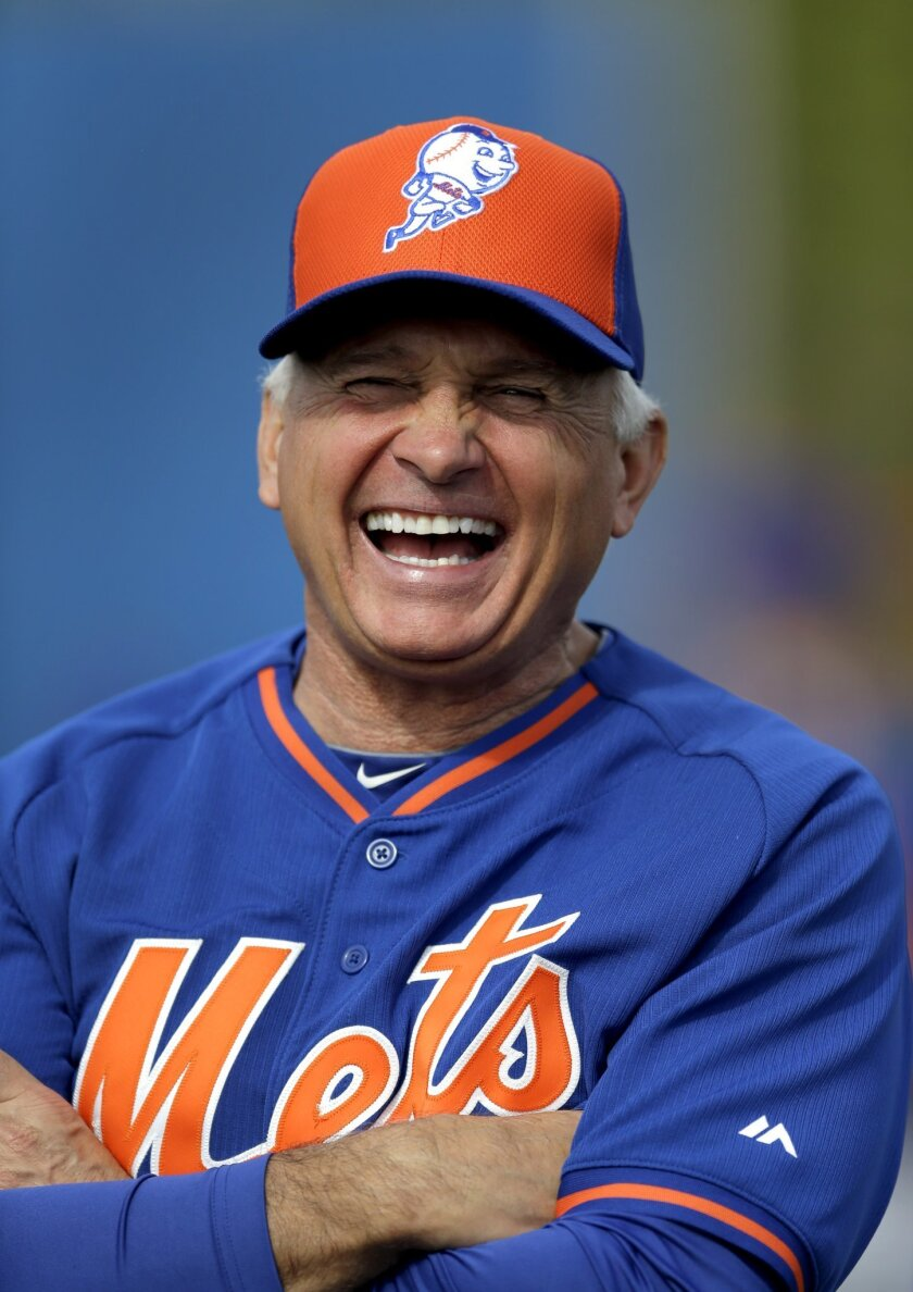 New York Mets manager Terry Collins laughs during spring training baseball practice Saturday, Feb. 21, 2015, in Port St. Lucie, Fla. (AP Photo/Jeff Roberson)