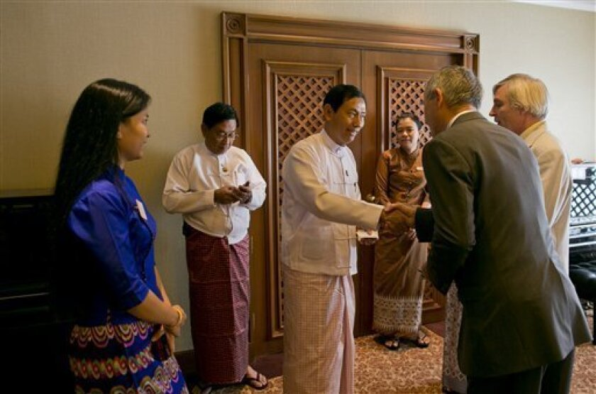 """Than Htay, Myanmar's minister of energy, third left, shakes hands with foreign participants to """"Myanmar Upstream Summit"""", an oil and gas conference in Yangon, Myanmar, Monday, March 4, 2013. Myanmar plans to put over 20 offshore oil and gas exploration blocks up for auction by April, government off"""