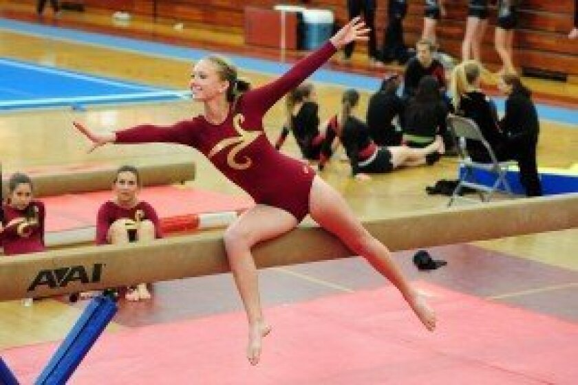 A Torrey Pines gymnast performs on the balance beam at a meet on April 4. Photo/Anna Scipione