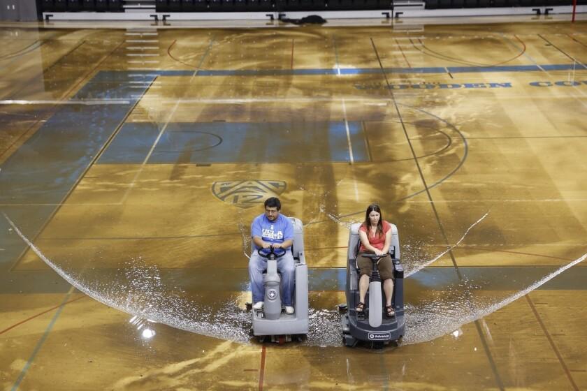 Water is cleared from the floor of Pauley Pavilion on the UCLA campus after a water main broke on Sunset Boulevard.