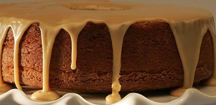 """Luscious caramel glaze spills down a brown sugar pound cake, one of the many easy-to-make recipes in """"Southern Cakes."""""""