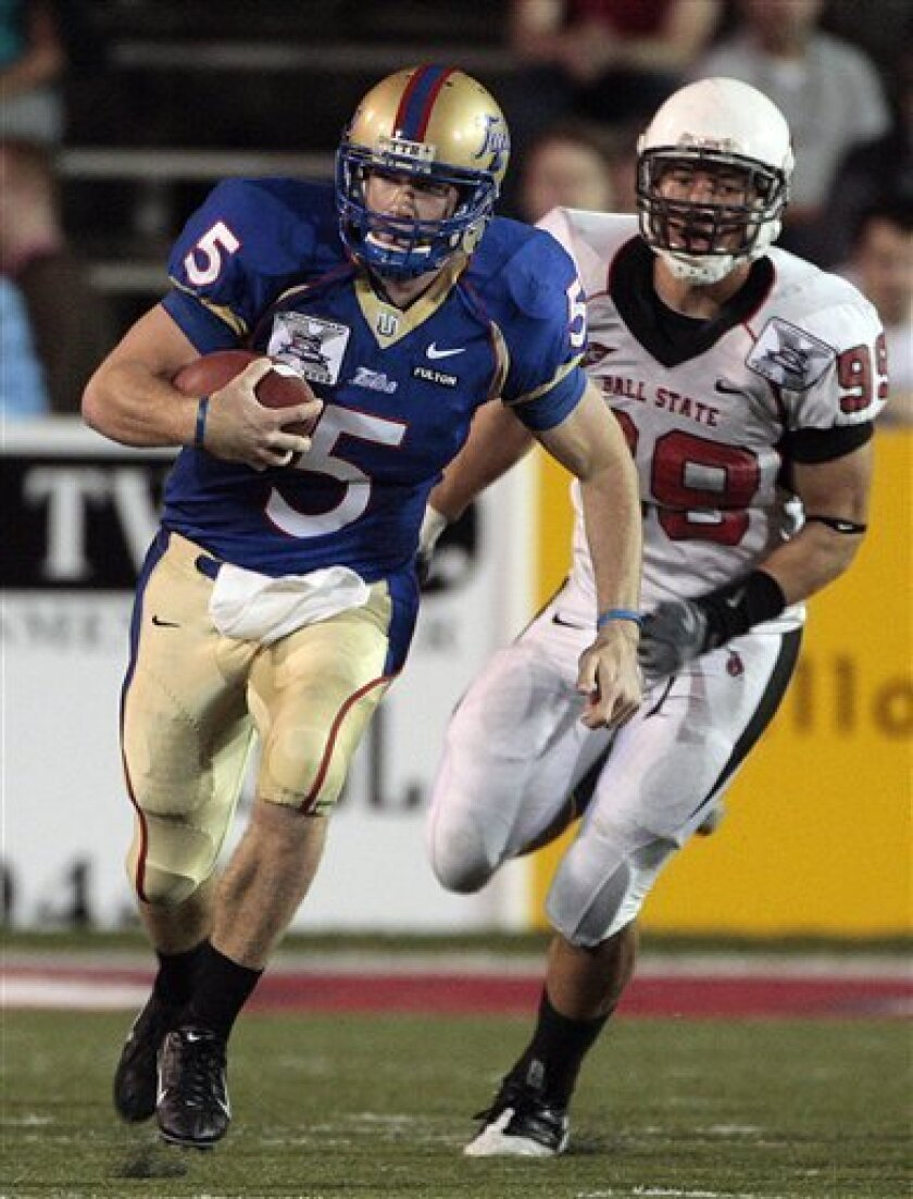 Tulsa quarterback David Johnson (5) outruns the defense of Ball State's Kenny Meeks during the GMAC Bowl NCAA college football game at Ladd-Peebles Stadium in Mobile, Ala., Tuesday, Jan. 6, 2009. (AP Photo/Dave Martin)
