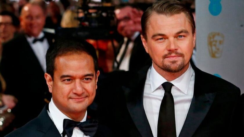 """The Wolf of Wall Street"" producer Riza Aziz, at left with the film's star Leonardo DiCaprio, attends a 2014 awards show."