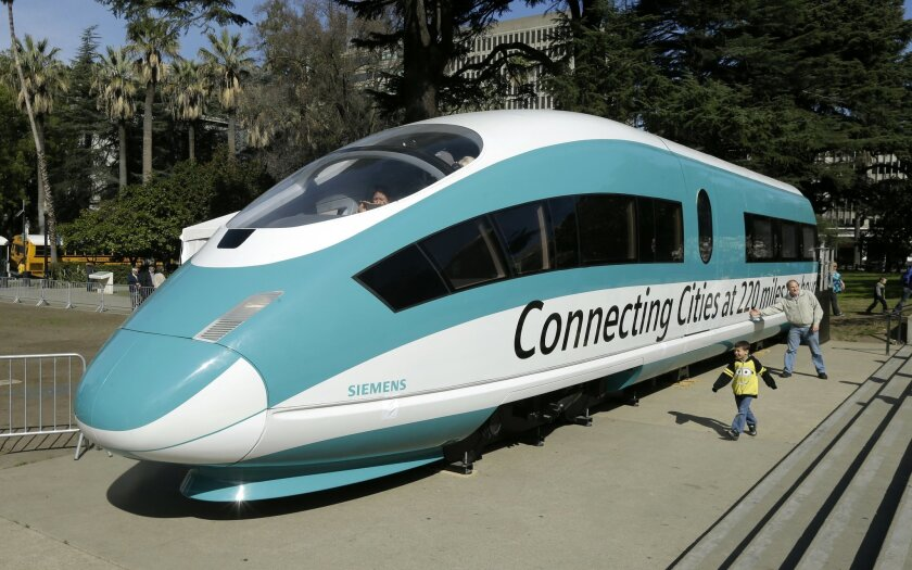 In this Feb. 26, 2015 photo, a full-scale mock-up of a high-speed train is displayed at the Capitol in Sacramento, Calif. In recent decades, political pressure against bullet trains has come from conservatives who argue that such systems should acquire private financial backing and prove that their operations will at minimum be cost-neutral. It's a burden state and federal governments do not place on other huge transportation projects such as freeways and airports. (AP Photo/Rich Pedroncelli)