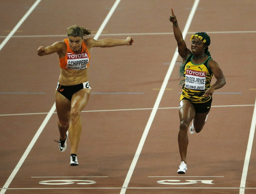 FILE - In this Aug. 24, 2015, file photo, silver medal winner Dafne Schippers of the Netherlands, left, and Jamaica's gold medal winner Shelly-Ann Fraser-Pryce compete in the women's 100m final during the World Athletics Championships at the Bird's Nest stadium in Beijing. There's extra incentive for the 29-year-old Fraser-Pryce in Rio, the chance to be the first woman to win the same individual event at three successive Olympics. (AP Photo/Ng Han Guan, File)