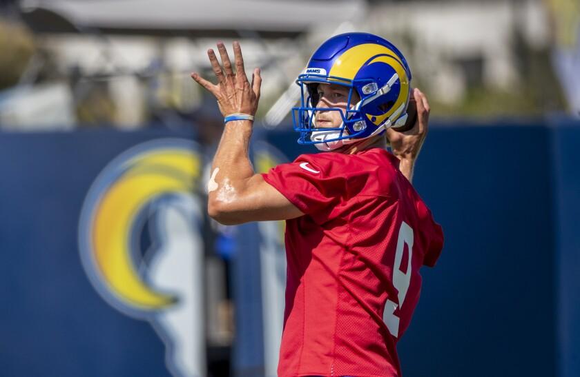 Rams starting quarterback Matthew Stafford looks to pass during camp practice.
