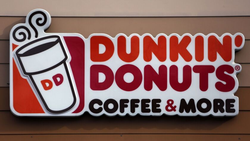 FILE- In this Jan. 22, 2018, file photo shows the Dunkin' Donuts logo on a shop in Mount Lebanon, Pa