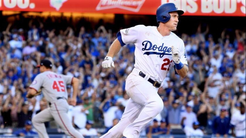 Dodgers second baseman Chase Utley drives in the go-ahead run in the eighth inning of Game 4 of the National League division playoff series against the Washington Nationals on Oct. 11, 2016.