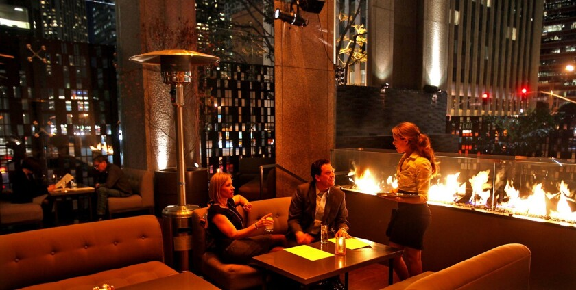 A massive fireplace warms patrons who eat and drink at Le Ka's massive outdoor terrace.