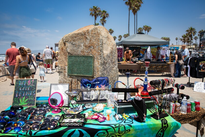 Street vendors set up at Veterans Plaza in Ocean Beach in July.