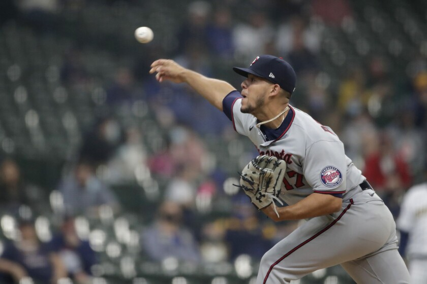 Minnesota Twins' Jose Berrios pitches during the first inning of a baseball game against the Milwaukee Brewers, Saturday, April 3, 2021, in Milwaukee. (AP Photo/Aaron Gash)