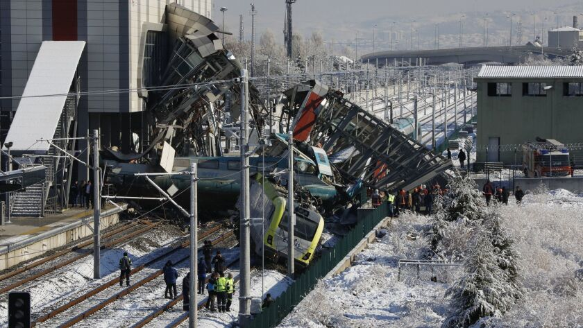 Members of rescue services work at the scene of a train accident in Ankara, Turkey, Thursday, Dec. 1