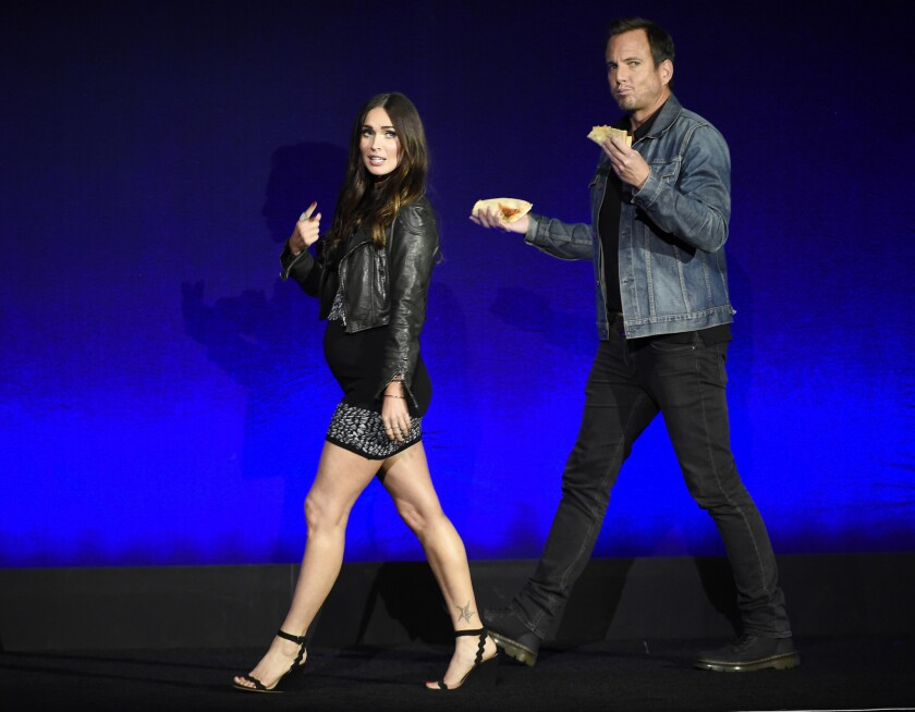 "Megan Fox and Will Arnett, cast members in the upcoming film ""Teenage Mutant Ninja Turtles: Out of the Shadows,"" take the stage during the Paramount Pictures presentation at CinemaCon 2016."