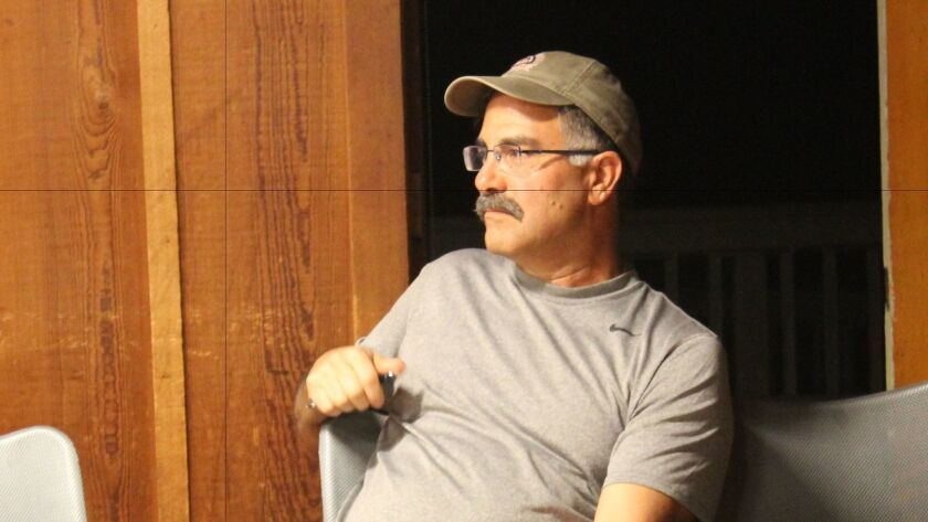 Shores district business owner Nader Hamdan faced Steve Lindsay with questions and concerns.
