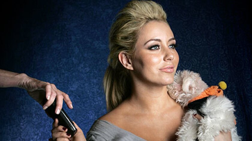 Aubrey O'Day, formerly of music group Danity Kane, and her dog Ginger.