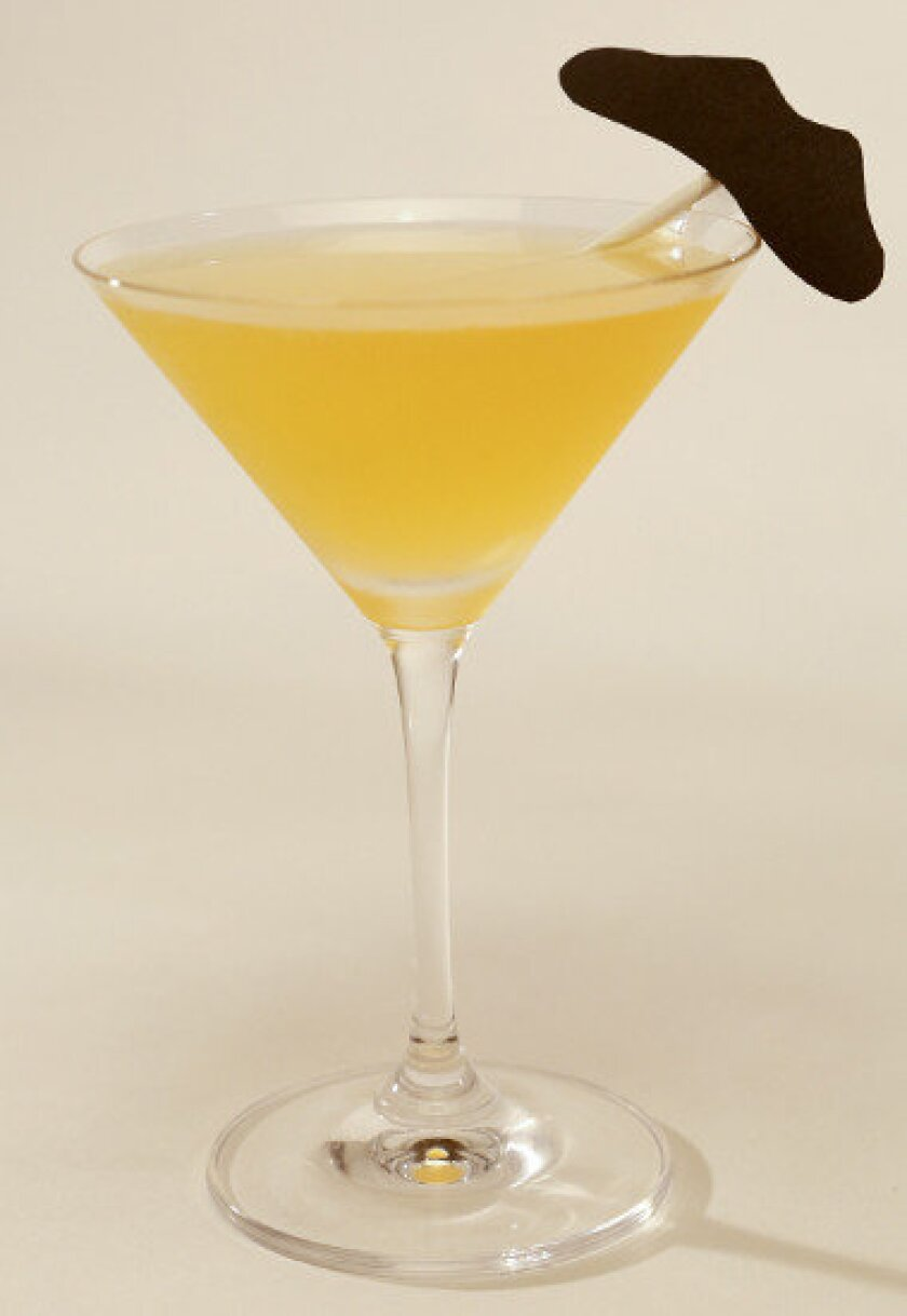 Even with a fake mustache, you can't disguise the fun of the Porn Star cocktail. Recipe: Porn Star Cocktail