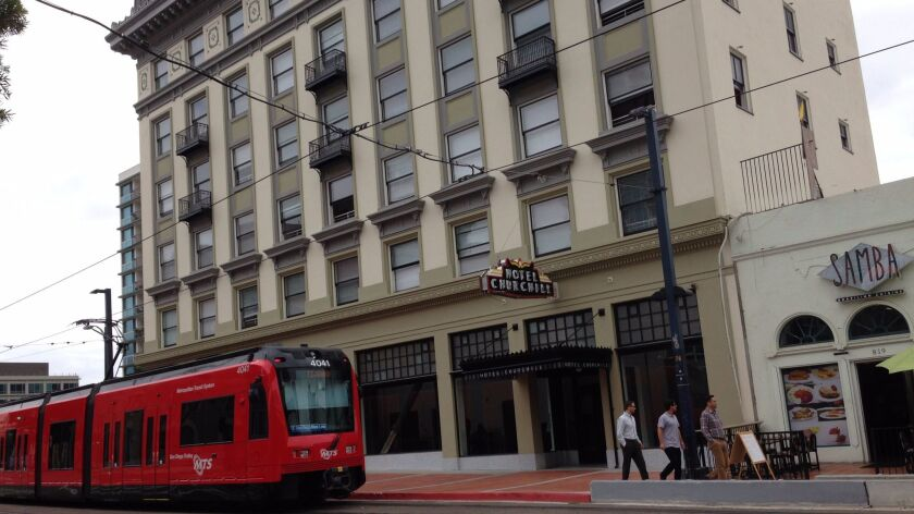 The Hotel Churchill, built in 1914, reopened in September as permanent housing 72 homeless individuals. Redevelopment helped fund the project.