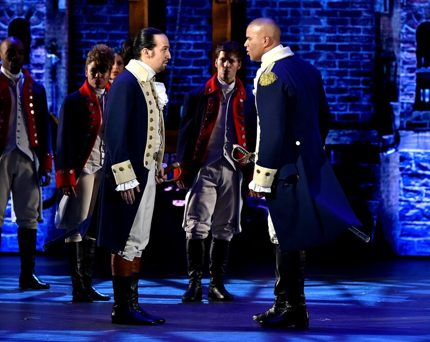 "Christopher Jackson as George Washington, right, and Lin-Manuel Miranda as Alexander Hamilton face off to sing ""Yorktown (The World Turned Upside Down)"" at the Tony Awards."