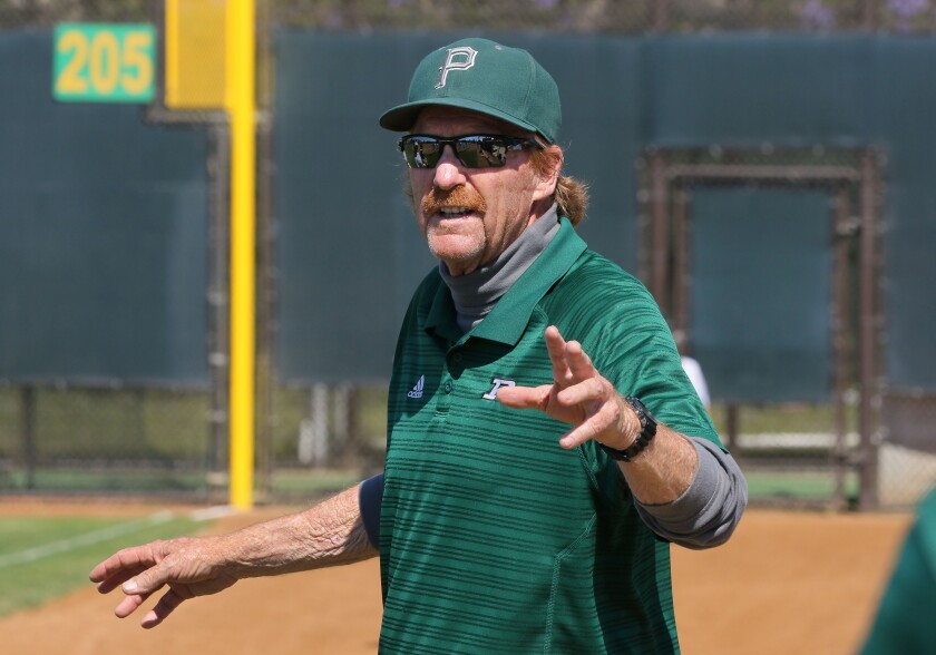 Poway coach Jim Bennet speaks to his players.
