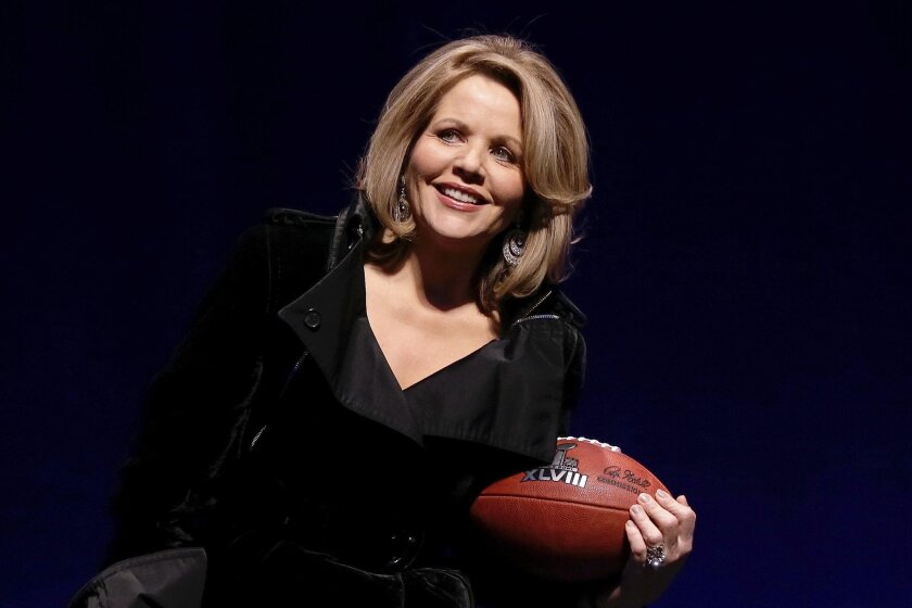 Opera singer Renee Fleming who will sing the National Anthem before the NFL Super Bowl XLVIII football game holds the game ball during a press conference Thursday, Jan. 30, 2014, in New York. (AP Photo/)