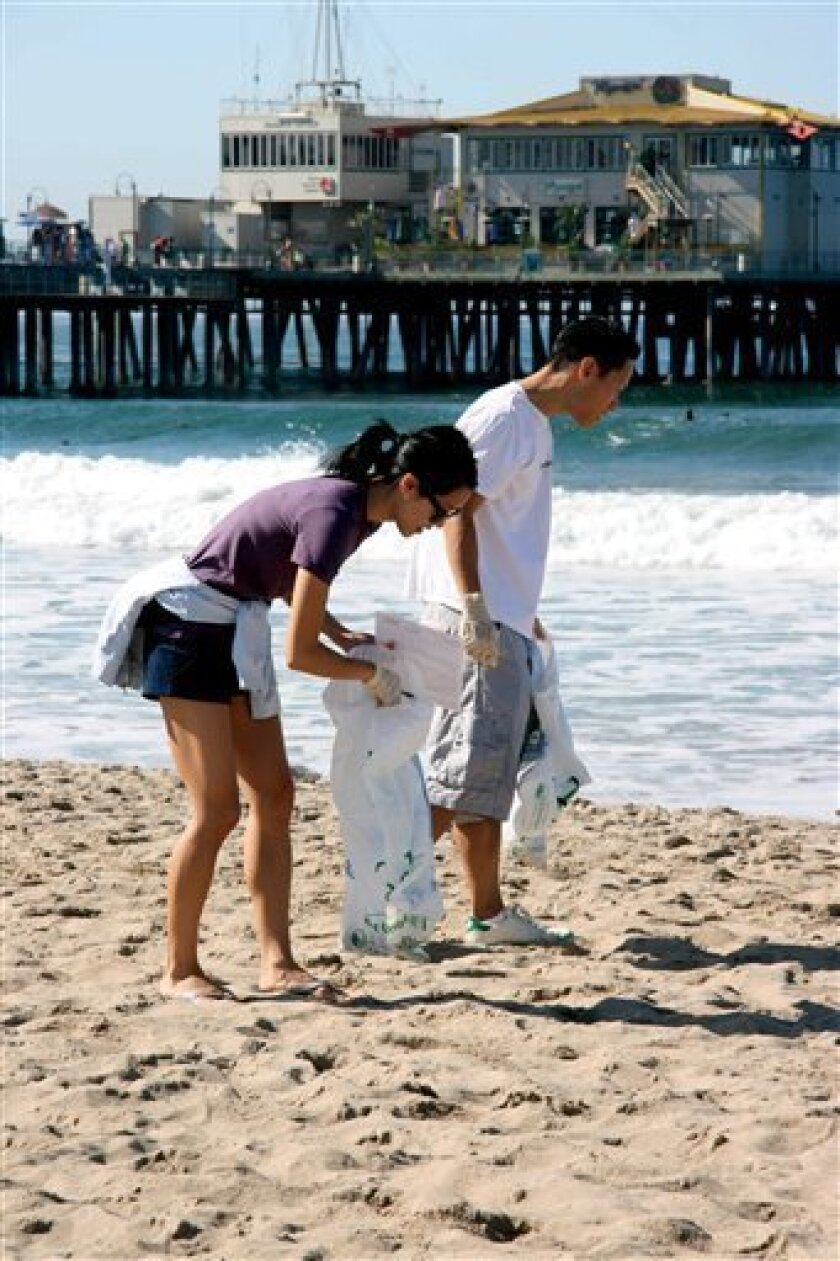A September, 2008 handout photo released by The Ocean Conservancy Tuesday, March 10, 2009 shows volunteers picking up beach trash in Santa Monica, Calif. during the 2008 International Coastal Cleanup. According to the group's report released Tuesday, nearly 400,000 volunteers scoured about 17,000 m