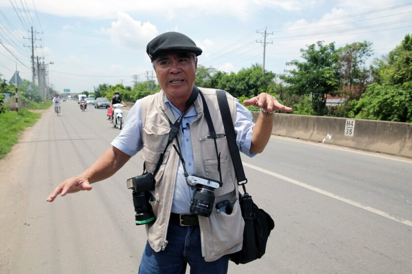 """Nick Ut at the location where he took his iconic """"napalm girl"""" photo in Trang Bang, Vietnam."""