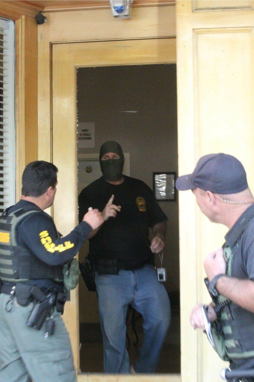 Law enforcement agents raid One On One PA marijuana dispensary on Sixth Avenue Tuesday morning.
