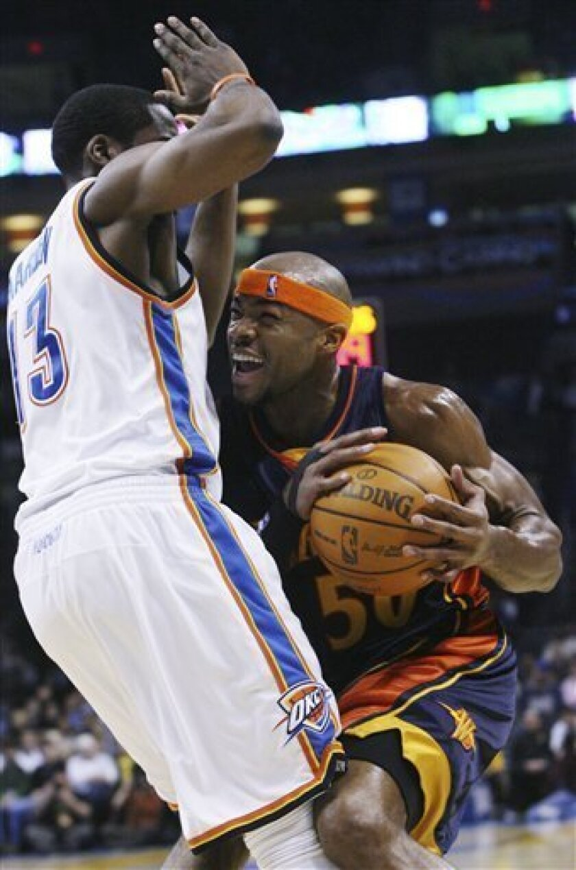 Golden State forward Corey Maggette, right, is fouled by Oklahoma City Thunder guard James Harden, left, in the first quarter of an NBA basketball game in Oklahoma City, Sunday, Jan. 31, 2010. (AP Photo/Sue Ogrocki)