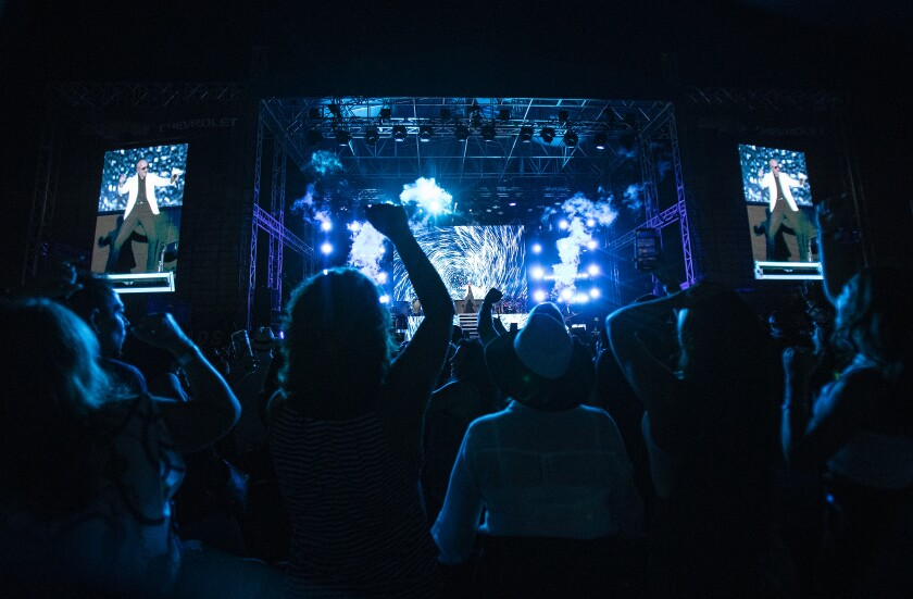 Fans cheer as Pitbull performs at the L.A. County Fair on Sept. 12, 2019.