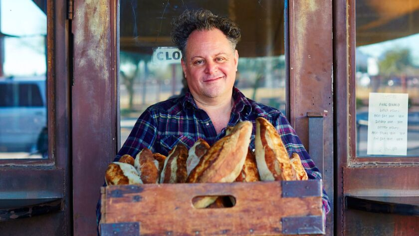 Chris Bianco with a box of his bread outside of Pane Bianco in Phoenix.