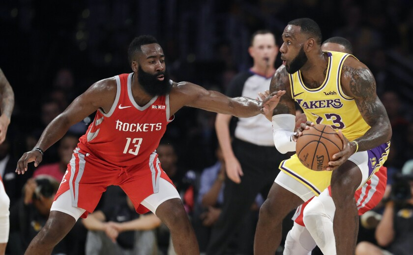 James Harden guards LeBron James.