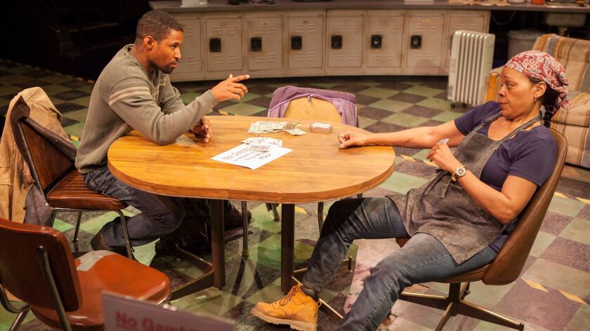 """Amari Cheatom as Dez and Tonye Patano as Faye in Dominique Morisseau's """"Skeleton Crew,"""" playing through May 7 at The Old Globe's Sheryl and Harvey White Theatre in Balboa Park."""
