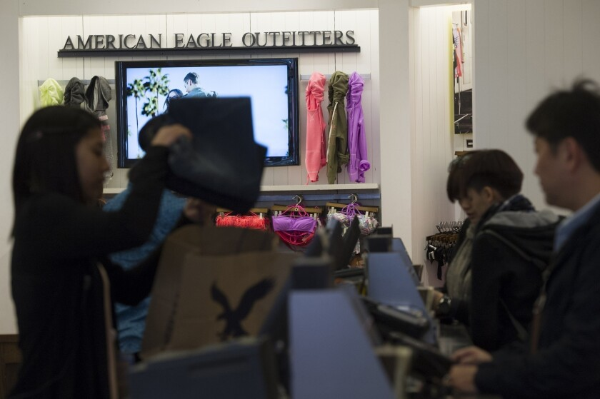 Customers purchase clothing at an American Eagle Outfitters Inc. store in San Francisco.