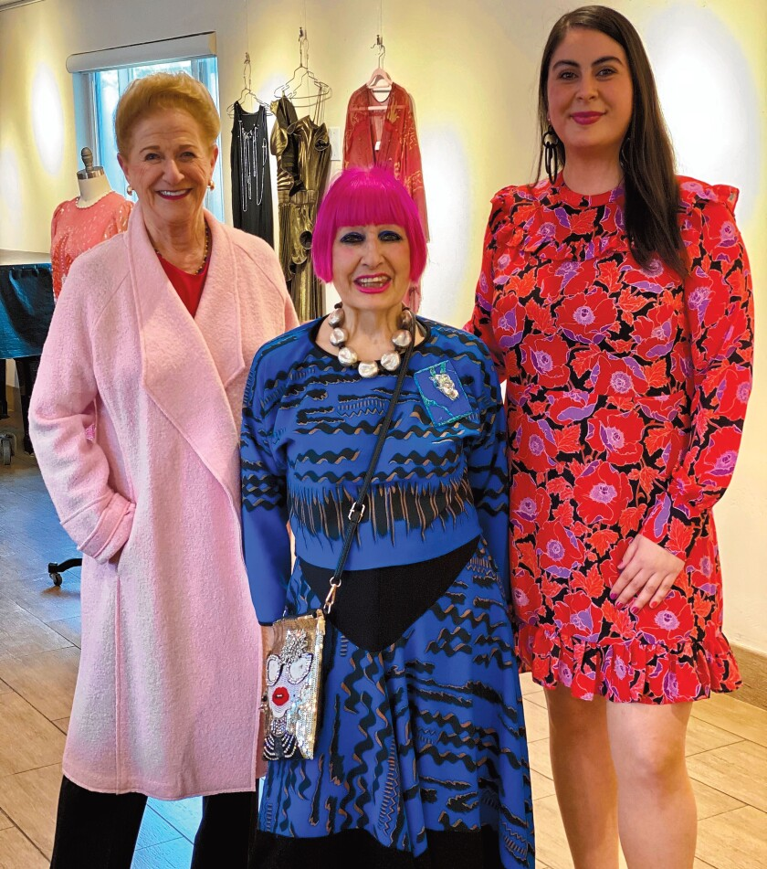 Fashion designer Zandra Rhodes (center) poses with Distinguished Speaker Series underwriter Judy White (left), and La Jolla Community Center executive director Nancy Walters. Rhodes was the featured presenter at La Jolla Community Center's Distinguished Speaker Series on March 3, 2020.